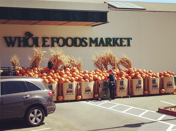 An impressive display of pumpkins outside of Whole Foods