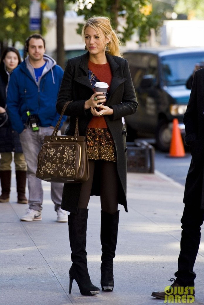 Blake Lively on the set of Gossip Girl in a red sweater and sequined skirt