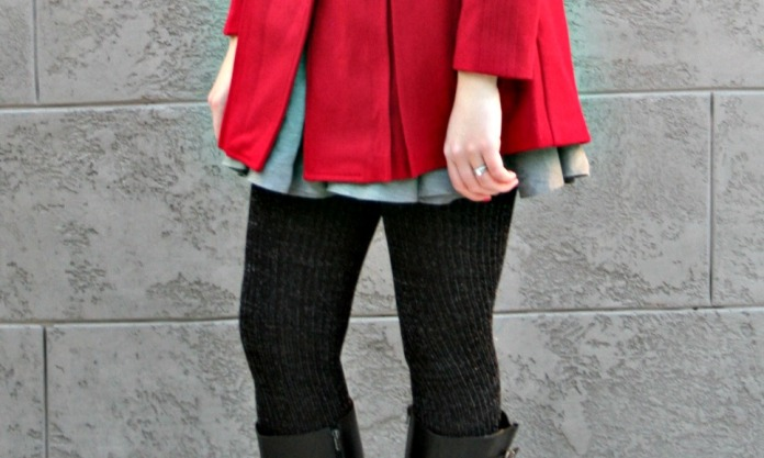 Close-up of red Modcloth coat and grey skirt layering